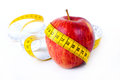 Diet concept apple measuring tape white Royalty Free Stock Images
