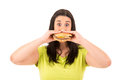 Diet concept beautiful large woman could not resist to an appetizing hamburger and kills her Royalty Free Stock Images