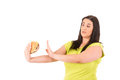 Diet concept beautiful large woman trying to resist to an appetizing hamburger which would kill her Stock Photo
