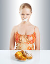 Diet concept woman mouth sealed duct tape dreaming biscuits buns Royalty Free Stock Photo