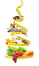 Diet concert food pyramid with measure tape Royalty Free Stock Images