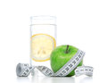 Diet diabetes weight loss concept tape measure organic green apple glass drinking water lemon white background focus water Stock Photography