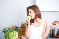 Diet dieting concept healthy food beautiful young woman choosing between fruits and sweets Royalty Free Stock Image