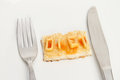 Diet dieting concept toast with the word spelled with alphabet pasta on a plate with a knife and fork Royalty Free Stock Photo