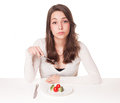 Diet dilemma portrait of a beautiful young brunette woman in Royalty Free Stock Photography
