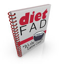 Diet fad book dieting craze best seller a spiral bound with the words it s the latest to illustrate a new sensation inside a Royalty Free Stock Photo