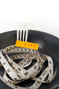 Diet food concept messages plate fork and measure tape Stock Photos