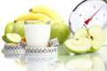 Diet food milk glass, fruit Apple meter scales Royalty Free Stock Photo