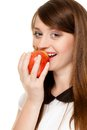 Diet girl eating biting apple seasonal fruit and nutrition happy young woman isolated on white recommending healthy lifestyle Royalty Free Stock Image