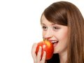 Diet girl eating biting apple seasonal fruit and nutrition happy young woman isolated on white recommending healthy lifestyle Royalty Free Stock Photography