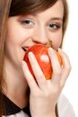 Diet girl eating biting apple seasonal fruit and nutrition happy young woman isolated on white recommending healthy lifestyle Royalty Free Stock Photo