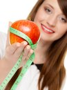 Diet girl holding apple with measure tape and nutrition happy young woman fruit isolated on white recommending healthy food Royalty Free Stock Photo