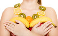 Diet girl with necklace of fresh citrus fruits isolated and earrings holding bananas woman recommending healthy nutrition Royalty Free Stock Image
