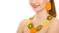 Diet girl with necklace of fresh citrus fruits isolated happy and earrings on white young woman recommending healthy food and Royalty Free Stock Photo