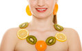 Diet girl with necklace of fresh citrus fruits isolated happy and earrings on white young woman recommending healthy food and Royalty Free Stock Photos