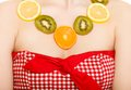 Diet girl with necklace of fresh citrus fruits isolated happy on white young woman recommending healthy food and nutrition Stock Photo