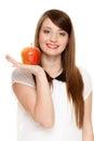 Diet. Girl offering apple seasonal fruit. Royalty Free Stock Photo