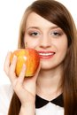 Diet. Girl offering apple seasonal fruit. Royalty Free Stock Photo