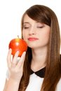 Diet girl smelling apple seasonal fruit and nutrition young woman isolated on white recommending healthy lifestyle Stock Photo
