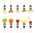 Diet and healthy eating concept fruits vegetables on the collection of forks with the place for your text Stock Photos