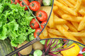 Diet lifestyle choice concept with zipper revealing fruits and vegetables on one side and french fries on the other Stock Images