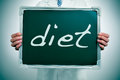 Diet a man wearing a white coat showing a chalkboard with the word written in it Royalty Free Stock Photography