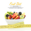 Diet meal fruit salad in a bowl with measuring tape Stock Image