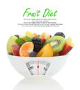 Diet meal fruit salad in a bowl with weight scale Stock Photos
