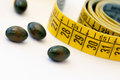 Diet - measuring tape and pills Stock Images