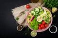 Diet menu. Healthy lifestyle. Vegan salad of fresh vegetables - tomatoes, cucumber, watermelon radish and avocado Royalty Free Stock Photo