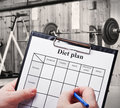 Diet plan against trainers and sports equipment Stock Photos