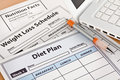 Diet Plan and Weightloss Schedule by Laptop Royalty Free Stock Photo