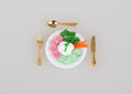 Diet portion tiny of food on plate Stock Photo