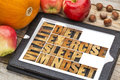 Diet sleep exercise and mindset vitality concept abstract in vintage letterpress wood type on a digital tablet with apples pumpkin Royalty Free Stock Photos