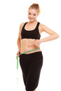 Diet. slim blonde girl with measure tape measuring waist Royalty Free Stock Photo
