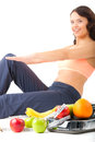 Diet and sport - young woman is doing sit-ups Stock Photos