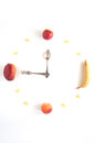Diet time fruit clocks made of grapes banana apple mango and peach Stock Photos