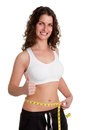 Diet time woman measuring her waist with a yellow measuring tape isolated in white Royalty Free Stock Images