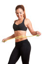 Diet time woman measuring her waist with a yellow measuring tape isolated in white Royalty Free Stock Photography