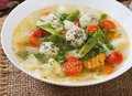 Diet vegetable soup with chicken meatballs and fresh herbs. Royalty Free Stock Photo