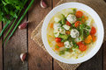 Diet vegetable soup with chicken meatballs and fresh herbs. Top view Royalty Free Stock Photo