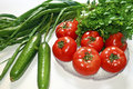 Diet vegetables tomato cucumber parsley and onions Royalty Free Stock Photo