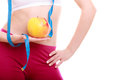 Diet. Waist of fit girl with measure tape apple Royalty Free Stock Photo