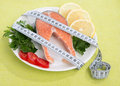 Diet weight loss concept fresh salmon steak for lunch with tape measure centimetr Royalty Free Stock Photos