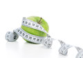 Diet weight loss concept green apple healthy and tape measure on a white background Stock Photography