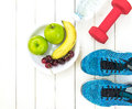 Diet and weight loss for healthy care with fitness equipment,fresh water and fruit healthy,apple green apple, banana,cherry on wh Royalty Free Stock Photo
