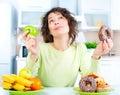 Diet. Woman Choosing Between F...