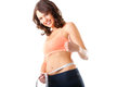 Diet - young woman is measuring her waist Royalty Free Stock Photos