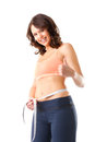 Diet - young woman is measuring her waist Stock Images