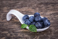 Dietary antioxidant blueberry fruit on a ceramic spoon horizontal photo Royalty Free Stock Images